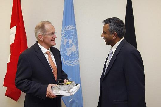 Amnesty International Secretary-General Salil Shetty (R) delivers petitions and postcards to incoming U.N. General Assembly President Joseph Deiss (L)