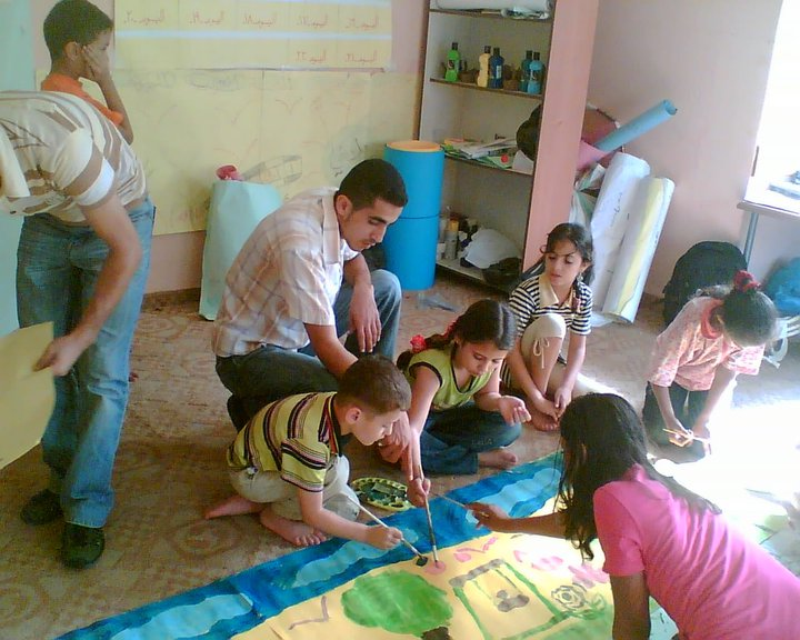 Abed helps children as part of work with Rowwad Foundation for Development Work.