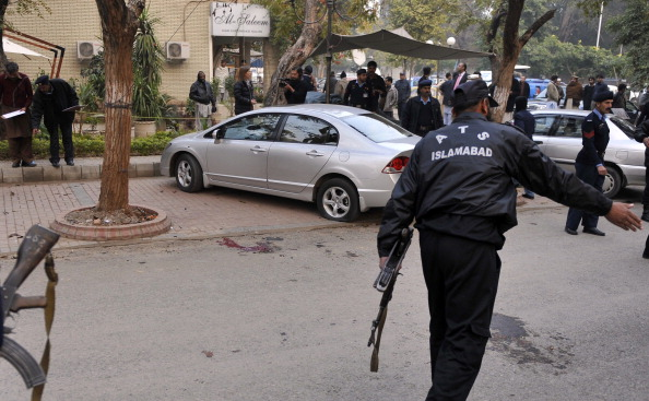 Pakistani policemen secure the site of a fatal attack on Salman Taseer, the governor of Pakistan's most politically important province Punjab, by his bodyguard in Islamabad on January 4, 2011. Salman Taseer, outspoken against the Taliban and other Islamist militants was assassinated on January 4, apparently for opposing blasphemy laws.  AAMIR QURESHI/AFP/Getty Images