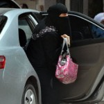 A Saudi woman gets out of a car after being given a ride by her driver in Riyadh © Fayez Nureldine/AFP/Getty Images