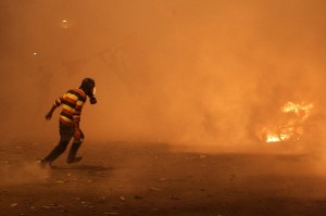 egyptian protester run tear gas