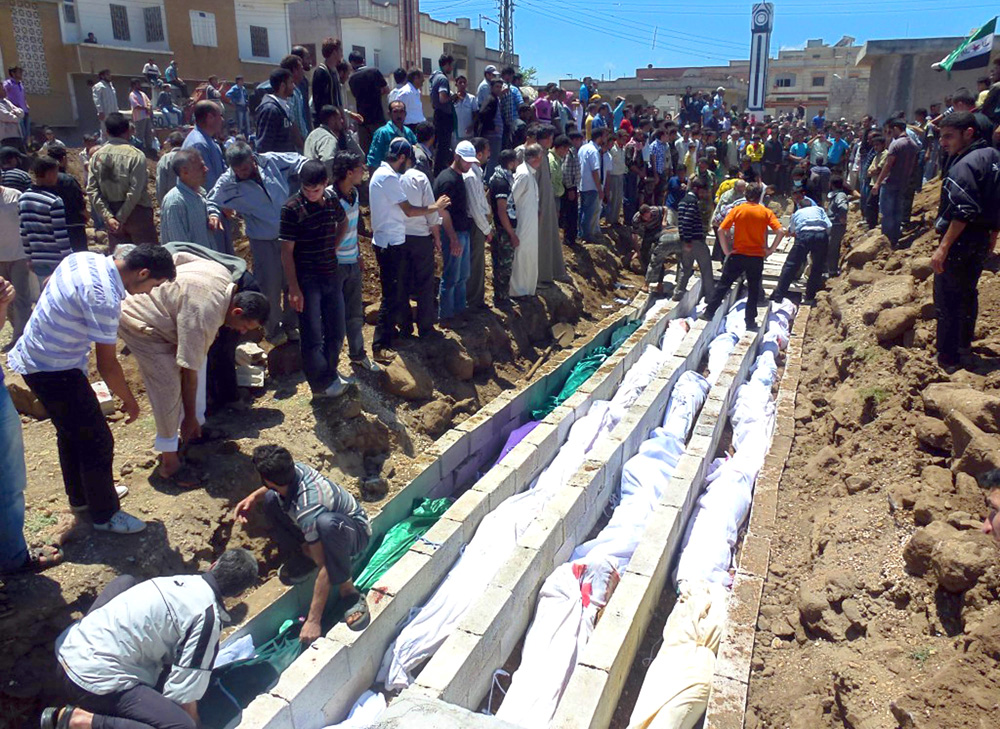 Burial of victims killed by Syrian forces in Houla, Syria