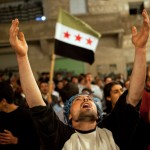 Demonstrator calls for freedom in Syria