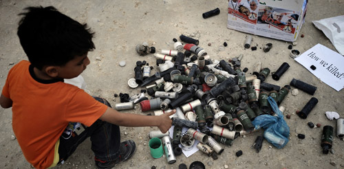 Bahraini boy with tear gas cannisters