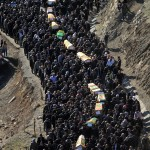 Kurds carry the coffins of victims of a Turkish air raid