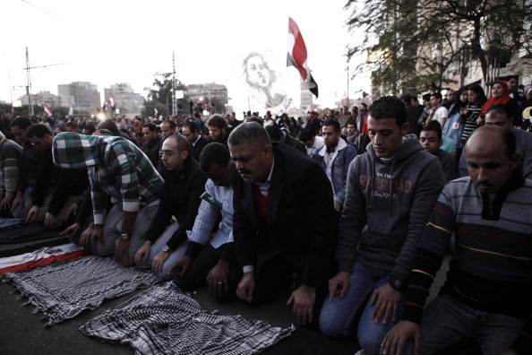 Egyptians hold a protest at the Presidential Palace
