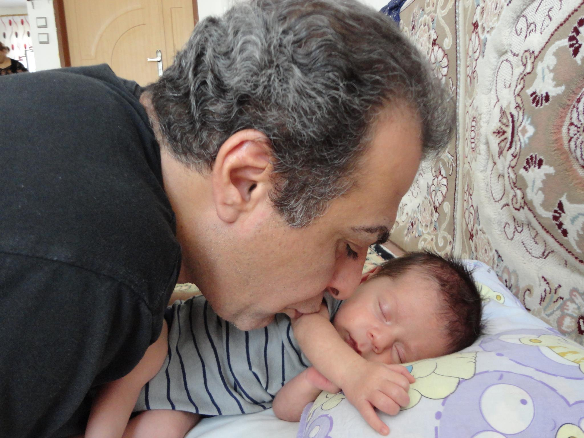 Behrouz with his newborn son, Harmang