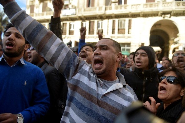 Egyptian protesters shout slogans against President Mohamed Morsi during a demonstration outside the high court in central Cairo on January 30, 2013.