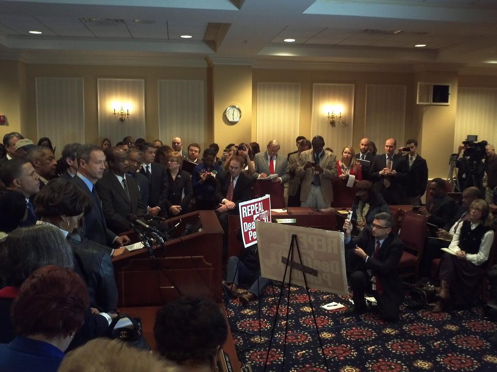 Maryland Governor Martin O'Malley speaks for death penalty repeal,  surrounded by supporters and the media.