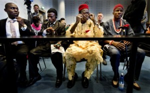 Four Nigerian farmers (L to R) Alali Efanga, Friday Alfred Akpan-Ikot Ada Udo, Chief Fidelis A. Oguru Oruma en Eric Dooh sit in the law courts in The Hague on October 11, 2012.