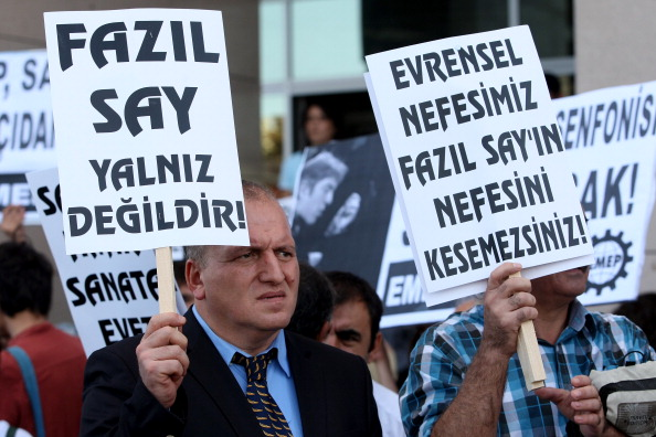 Supporter of Turkish pianist Fazil Say holds a sign in support of Say.
