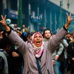 A woman protester waves the victory sign during clashes with military police near Tahrir Square.