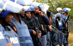 South African police  block a march by protesting miners in Rustenburg after a security crackdown in the restive platinum belt where officers shot dead 34 strikers (Photo Credit: Alexander Joe/AFP/GettyImages).