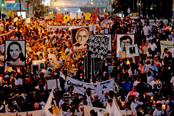 More than 10,000 Catholics gathered to commemorate the 30th anniversary of the assassination of of Archbishop Oscar Arnulfo Romero, a prominent human rights defender who was murdered during the Salvadorean civil war (Photo Credit: Jose Cabezas/AFP/Getty Images).