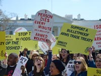 Amnesty activists rally outside the White House in support of a strong Arms Trade Treaty.