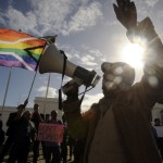A group of people from the gay, lesbian and transgender community in South Africa demonstrate outside the Parliament in Cape Town (Photo Credit: Rodger Bosch/AFP/GettyImages).