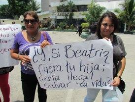 "Protesters at a demonstration outside the Supreme Court of Justice in San Salvador.  The sign reads, ""If Beatriz were your daughter, would it be illegal to save her life?""(Photo Credit: Courtesy of Agrupación Ciudadana por la despenalización del aborto Terapéutico, Ético y Eugénesico)."