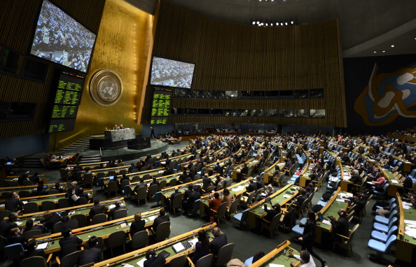Delegates to the United Nations General Assembly after passing the first UN treaty regulating the international arms trade (Photo credit: Timothy A. Clary/AFP/Getty Images)