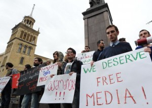 People hold posters as they mark World Press Freedom Day in Tbilisi (Photo Credit: Vano Shlamov/AFP/GettyImages).