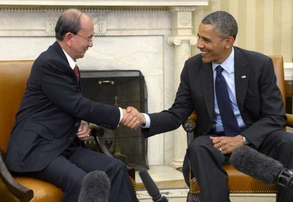 The warm White House reception, combined with Senate Minority Leader Mitch McConnell's call for the suspension of sanctions on imports from Myanmar, gave President Thein Sein a big boost. Did he deserve it? (Photo Credit: Shawn Thew, Pool/Getty Images).
