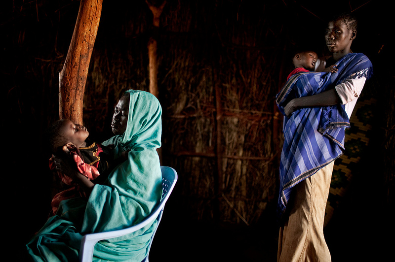 Healthcare and nutrition are some of the many ways that women worldwide invest their time and income in their families, well surpassing the amount of contribution from men (Photo Credit: Amnesty International).