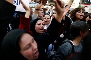 Whether in the public or private spheres, at the hands of state or non-state actors, violence against women in Egypt continues to go mostly unpunished (Photo Credit: Mahmud Khaled/AFP/Getty Images).