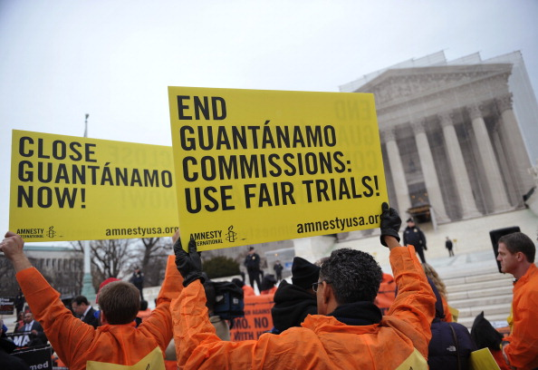 Demonstrators take part in a rally to call for the closing of the Guantanamo Bay detention center (Photo Credit: Mandel Ngan/AFP/Getty Images).
