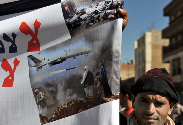 A Yemeni hold up a banner during a protest against U.S. drone attacks on Yemen. Strikes by U.S. drones in Yemen nearly tripled in 2012 compared to 2011 (Photo Credit: AFP/Getty Images).