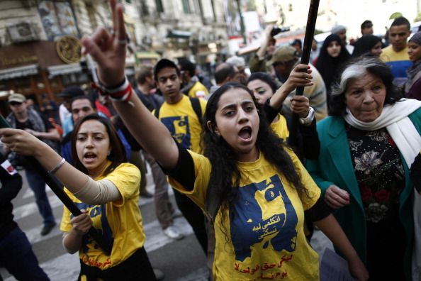 "Faced with a spike in sexual violence against female protesters, Egyptian women are overcoming stigma and recounting painful testimonies to force silent authorities and a reticent society to confront ""sexual terrorism"" (Photo Credit: Mahmud Khaled/AFP/Getty Images)."