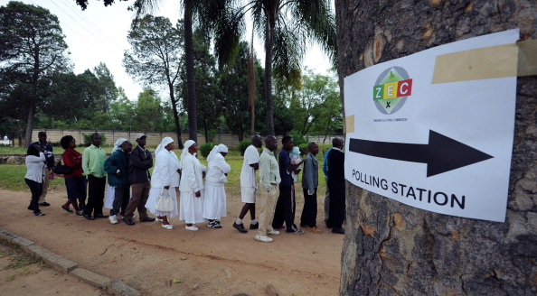 Zimbabweans queue in Chitungwiza to vote at a polling station in a school (Photo Credit: Alexander Joe/AFP/Getty Images).