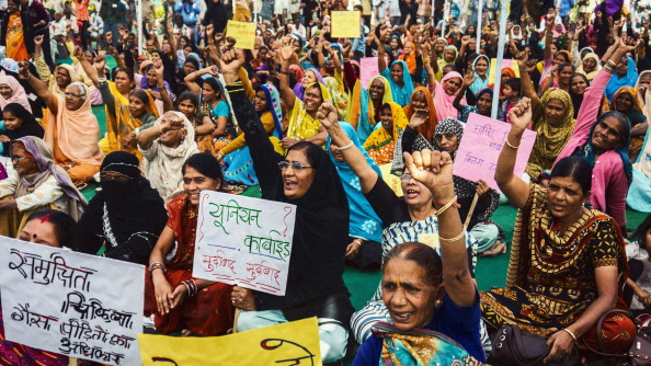 Gas victims protest at a rally demanding social justice and reparations for the victims of the Bhopal gas leak. The site has never been properly cleaned up and it continues to poison the residents of Bhopal (Photo by Giles Clarke/Getty Images).