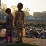 Two young girls stand outside the remains of the infamous Union Carbide plant in Bhopal, India. Half a million people were exposed during the plant's 1984 gas leak and 25,000 have died to date as a result of their exposure. More than 120,000 people still suffer from ailments ranging from blindness to gynaecological disorders caused by the accident and subsequent pollution (Photo Credit: Giles Clarke/Getty Images).