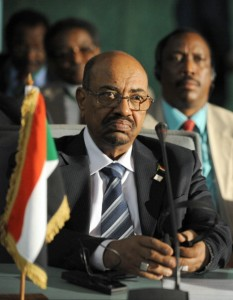 Sudan's President Omar al-Bashir takes part in the African Union Summit on health focusing on HIV/AIDS, TB and malaria. Nigeria's president defended welcoming Sudan President Omar al-Bashir to the African Union health summit despite war crimes charges against him, saying it could not interfere in AU affairs.     (Photo Credit: Pius Utomi Ekpei/AFP/Getty Images).
