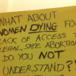 An activist's sign details consequences of limiting access to healthcare and abortions(Photo Credit: Sahare Wazirali).