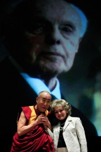 The Dalai Lama and Annette Lantos in front of a projection of the late U.S. Representative Tom Lantos. The Tom Lantos Human Rights Commission (TLHRC) was one of the creators of the Defending Freedoms Project (Photo Credit: Mark Wilson/Getty Images).
