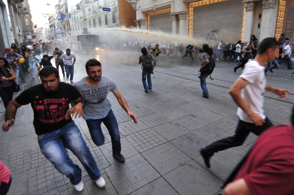 Turkish riot use water cannon to disperse anti-government protestors during clashes at Istiklal street on (Photo Credit: Ozan Kose/AFP/Getty Images).