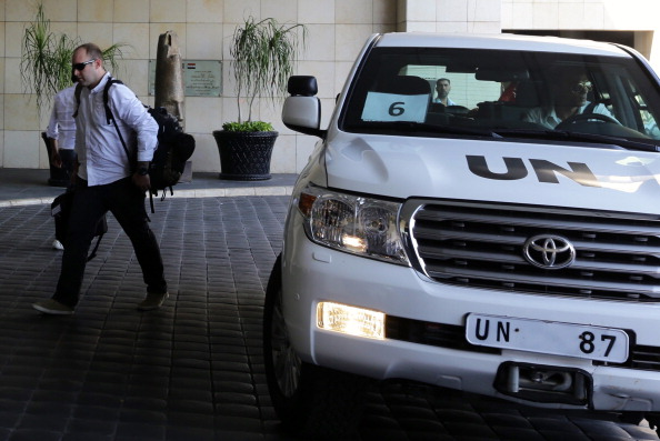 The U.N. chemical weapons investigation team arrives in Damascus on August 18, 2013 (Photo Credit: Louai Beshara/AFP/Getty Images).