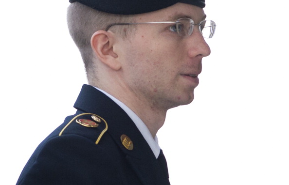 U.S. Army Private First Class Bradley Manning arrives at a U.S. military court facility to hear his sentence in his trial at Fort Meade, Maryland on August 21, 2013 (Photo Credit: Saul Loeb/AFP/Getty Images).