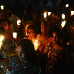 Activists hold lighted candles during a vigil on International Day of the Disappeared in Sri Lanka, where some 12,000 complaints of enforced disappearances have been submitted to the U.N. since the 1980s (Photo Credit: Lakruwan Wanniarachchi/AFP/Getty Images).