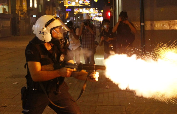 A riot police fires tear gas at demonstrators during a protest in Istanbul, Turkey (Photo Credit: Bulent Doruk/Anadolu Agency/Getty Images).