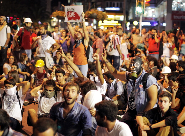 Protestors chant slogans on September 12, 2013 at Kadikoy in Istanbul (Photo Credit: Gurcan Ozturk/AFP/Getty Images).