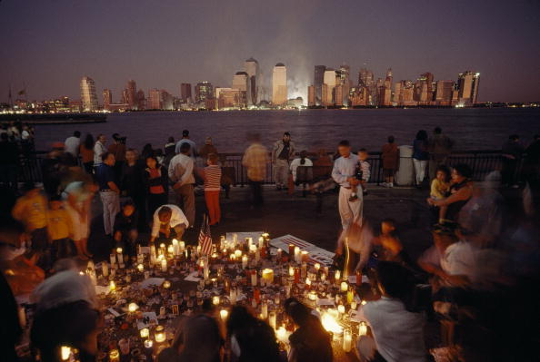 People at a candlelight vigil the night of September 12, 2001. New York City (Photo Credit: Lynn Johnson via Getty Images).