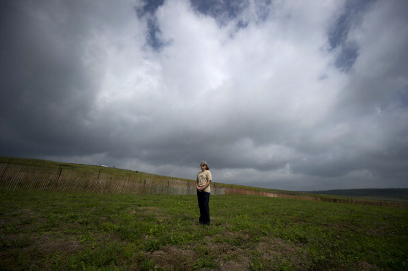 Sherry Chamberlain, 57, of Jumonville, PA, stands in a field during the dedication ceremony for the Flight 93 National Memorial September 10, 2011 in Shanksville, Pennsylvania (Photo Credit: Jeff Swensen via Getty Images).