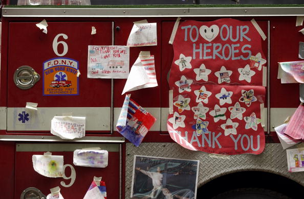 Drawings made by children decorate a New York City fire truck on Broadway near the scene of the World Trade Center wreckage, September 27, 2001, New York City (Photo Credit: Stand Honda, AFP via Getty Images).