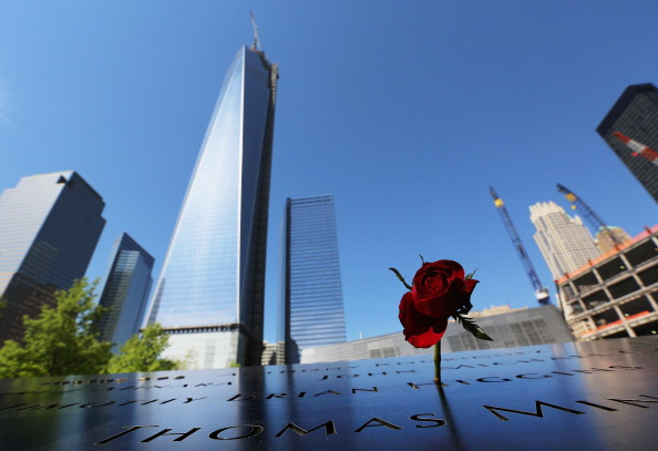 A rose stands at the 9/11 Memorial, New York City, May 16, 2013 (Photo Credit: Mario Tama via Getty Images).