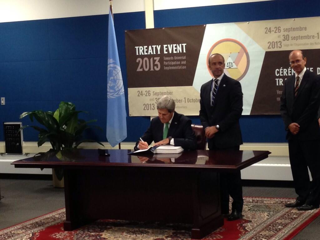 Secretary of State John Kerry signing the Arms Trade Treaty (Photo Credit: Adotei Akwei).