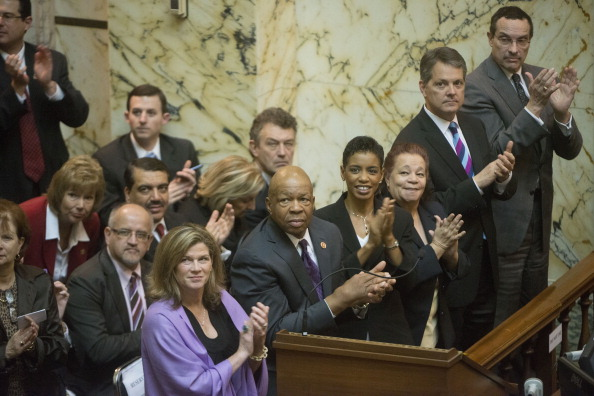 Andrea Hall was among the activists looking on when Gov. Martin O' Malley signed Maryland's death penalty abolition bill this May (Photo Credit: Marvin Joseph/The Washington Post via Getty Images).