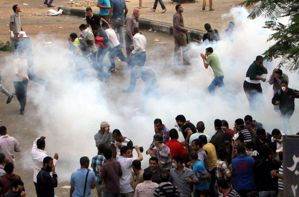 Egyptian security forces used tear gas to disperse pro-democracy activists during protests marking the 40th anniversary of the 1973 victory over the Israeli army at Ramses Square on October 6, 2013 in Cairo, Egypt (Photo by Salah Said/Anadolu Agency/Getty Images).