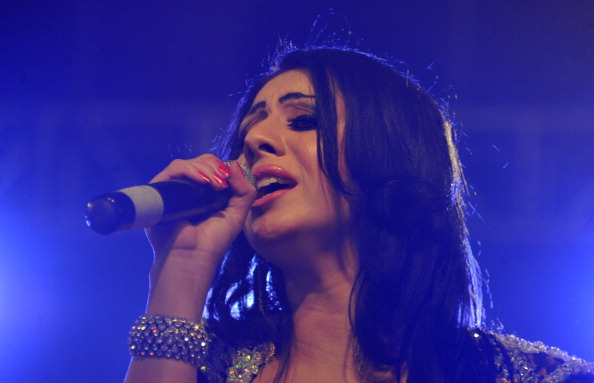 Afghanistan has a thriving media and entertainment industry. Here, Tajik singer Farida performs during a 'Peace Concert' in Babur Garden in Kabul (Photo Credit: Noorullah Shirzada/AFP/Getty Images).