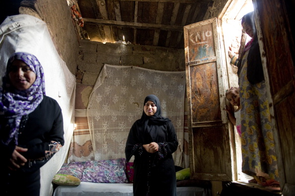 Residents of Egypt's slums are often cut off from basic public services, such as waste management and waste management (Photo Credit: Ann Hermes/The Christian Science Monitor via Getty Images).